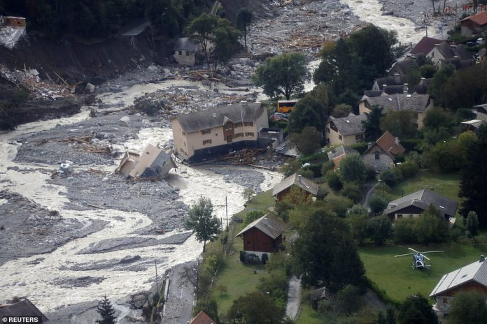 At least two people were killed in Saint-Martin-Vestubie amid the flooding (pictured), while two others died in villages further down the mountains. Four people have also been confirmed dead on the Italian side of the border