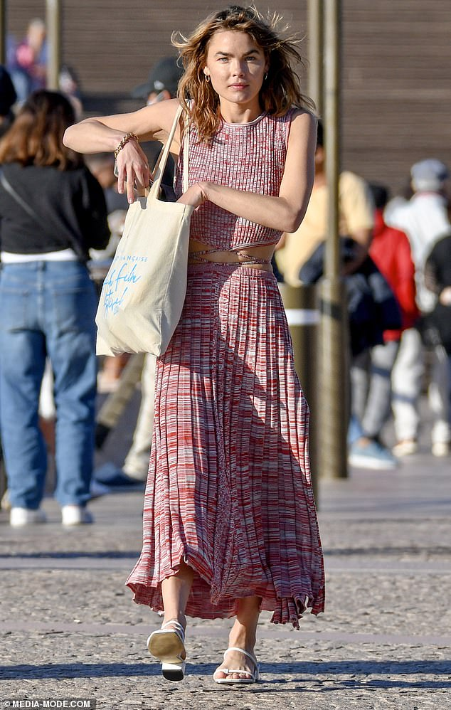 Expensive taste! Shewore a knitted red-and-white crop top worth $440 and a matching high-split midi skirt worth $550, both designed by Christopher Esber