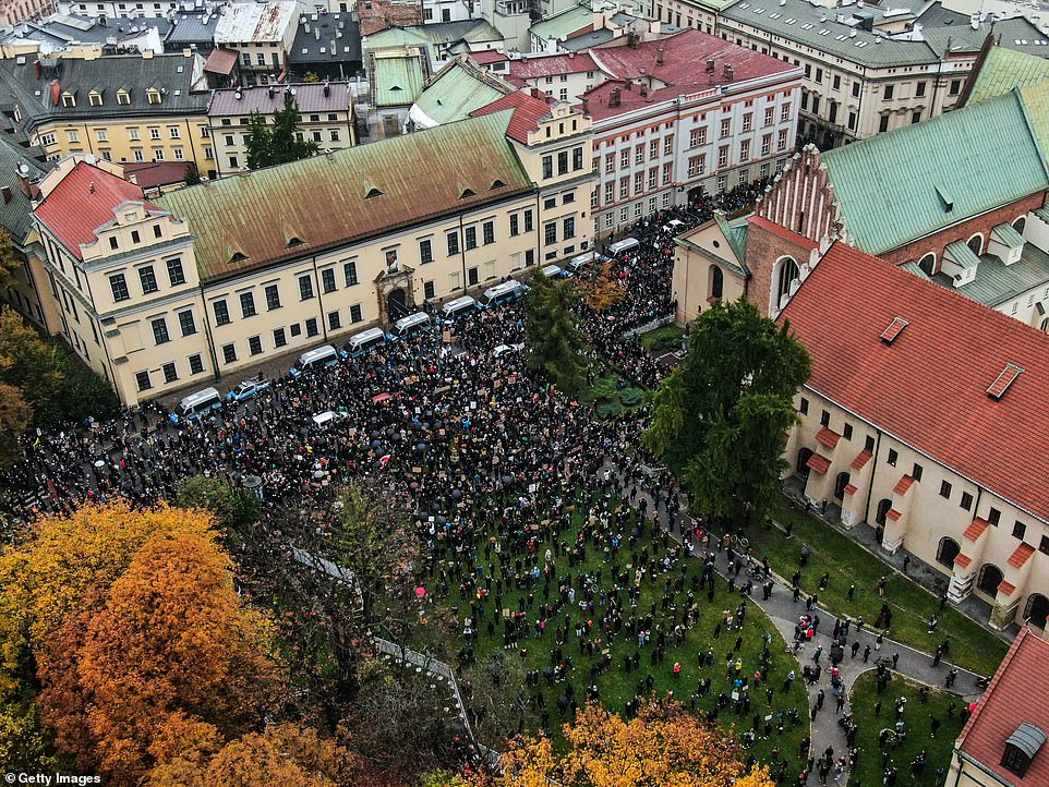 Pictured: An aerial view of thousands of protesters during the fourth day of demonstrations against the Constitutional Court ruling on tightening the abortion law in front of Krakow's Archbishop's Palace on October 25. Thousands can be seen gathering outside the building which has a line of police vans in front of it