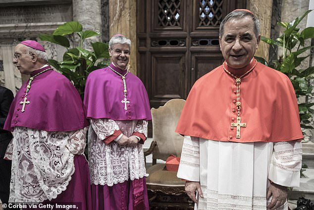 Cardinal Giovanni Angelo Becciu poses after a consistory ceremony lead by Pope Francis to create 14 new cardinals at St. Peters Basilica on June 28, 2018