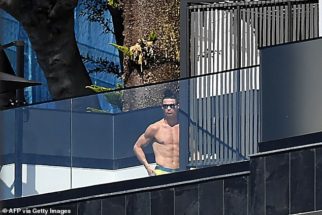 Portugal and Juventus forward Cristiano Ronaldo pictured standing on a balcony at his 7-storey home in Funcha in March