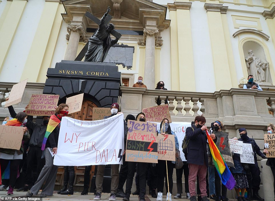 People protest in front of a church in Warsaw against Poland's abortion laws. The country's Constitutional Tribunal last week ruled in favour of a ban on abortions in cases of fetal defects, tightening Poland's already restrictive abortion laws