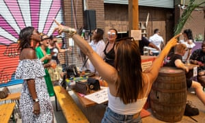 "People party whilst staying in their ""bubbles"", at a ""UKG Brunch Presents: UKG Big BBQ "" event"