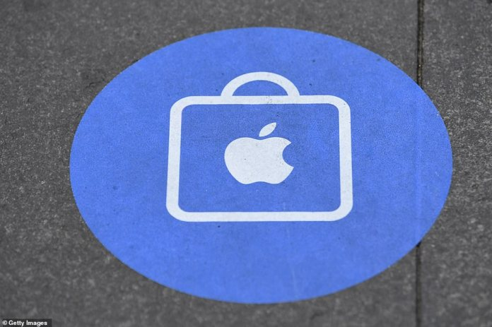 An Apple branded sticker to socially distance on the pavement outside the Apple Store in George Street as customers wait to look at the new iPhone 12