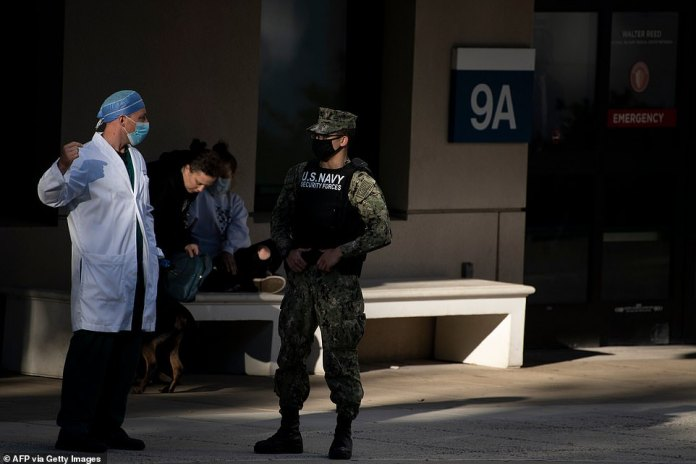 TheMedical Evaluation and Treatment Unit where Vice Presidents and Presidents are typically received has a private entrance. Pictured: Navy service members and doctors guard an emergency room entrance ahead of President Trump's arrival