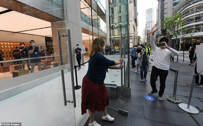 Staff open the Apple Store in George Street for customers to look at the new iPhone 12 on sale on October 23, 2020 in Sydney, Australia