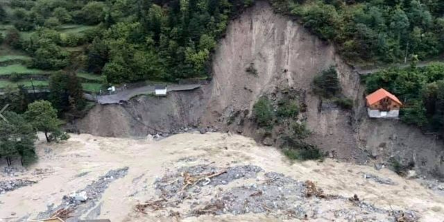 This aerial view provided Sunday, Oct. 4, 2020, by the Alpes Maritimes region fire brigade show a house keeping a fragile balance on a hill while a river floods Saturday, Oct. 3, 2020, near La Vesubie, southern France.