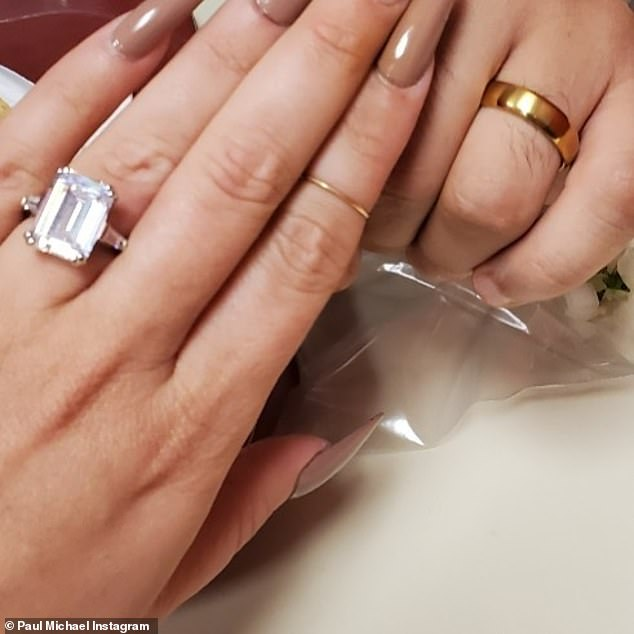 Glitz: Recently her fiance Paul Michael set off a storm of marriage speculation when he posted a picture of his and Amanda's hands wearing their engagement rings