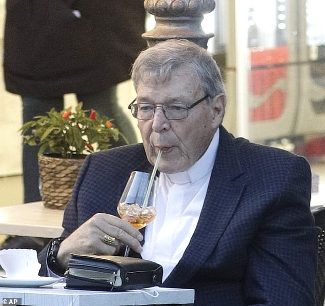 Cardinal George Pell has a drink in a cafe in Rome on Saturday