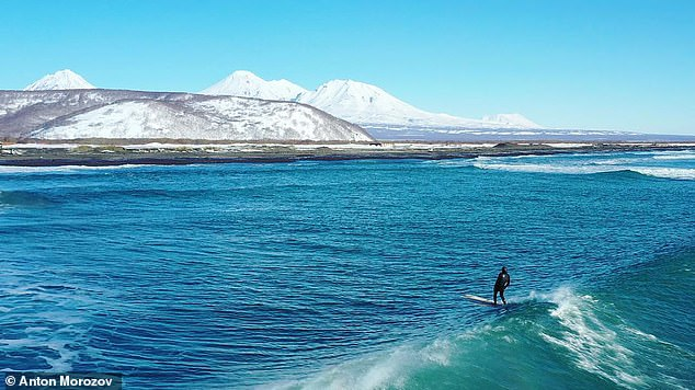 People have been warned to stay away from black-sand Khalaktyrsky beach on the country's Pacific shoreline. Pictured: Volcanoes and waves of Khalaktysky beach, Kamchatka, before the pollution