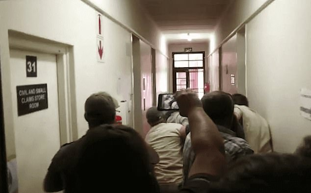 Footage purportedly taken inside the holding cells of the court show guards attempting to restrain furious protesters