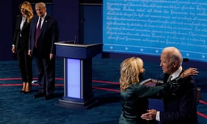 First lady Melania Trump and the president look on as Democratic presidential candidate Joe Biden hugs his wife Jill Biden after the first presidential debate in Cleveland, Ohio, on Tuesday 29 September
