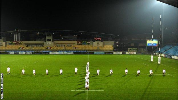 England players standing in the shape of a cross on the pitch
