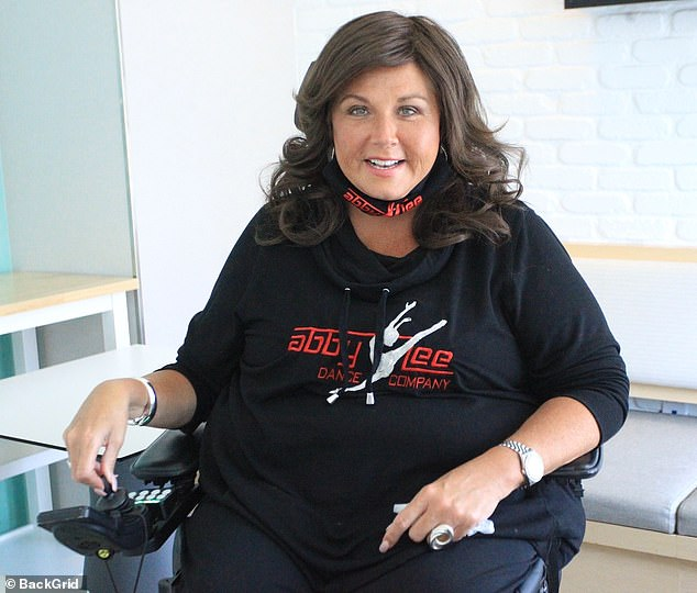Getting well: Abby Lee Miller spoke about a recent back surgery that is helping restore her ability to walk again; seen in May of this year