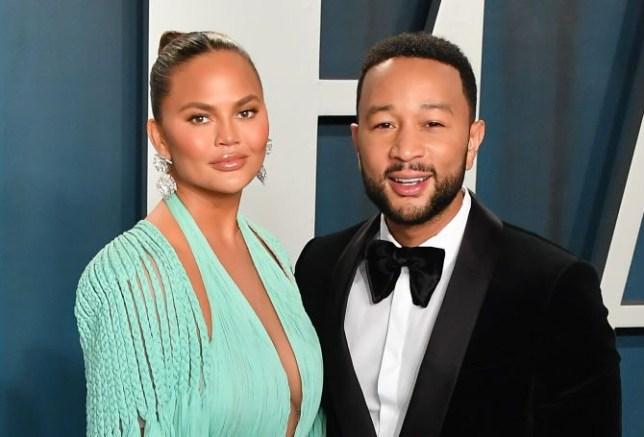 Chrissy Teigen and John Legend attend 2020 Vanity Fair Oscar Party Hosted By Radhika Jones - Arrivals