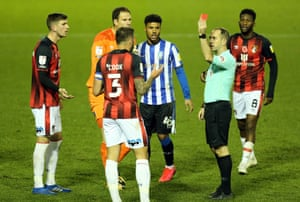 Bournemouth's Steve Cook is shown a red card by referee Jeremy Simpson for his foul on Sheffield Wednesday's Joey Pelupessy