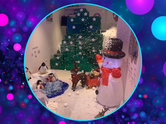 a home-made life-sized advent calendar complete with fake snow