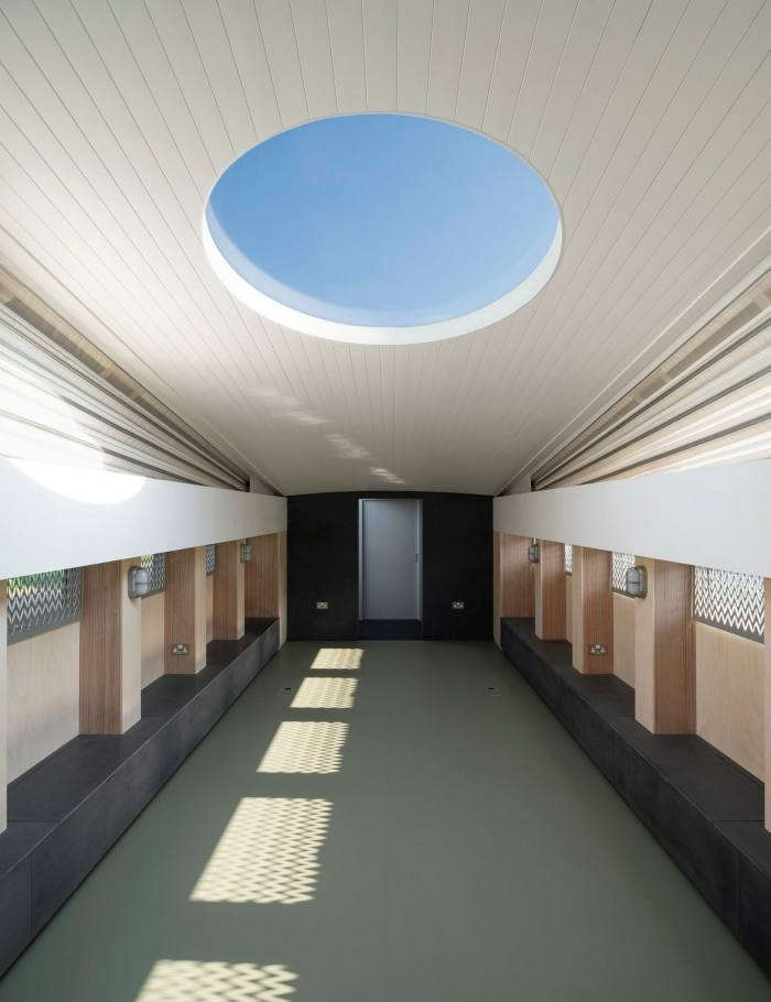The interior is entirely stripped of Christian paraphernalia, with a skylight giving a hint of James Turrell