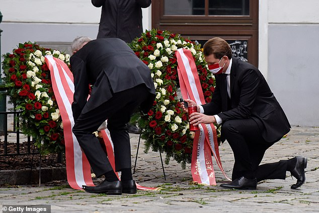 Austrian President Alexander Van de Bellen (left) and Chancellor Sebastian Kurz (right) lay wreaths in Vienna's city centre on November 3 following a terrorist attack the day before which has killed at least four people and wounded 22