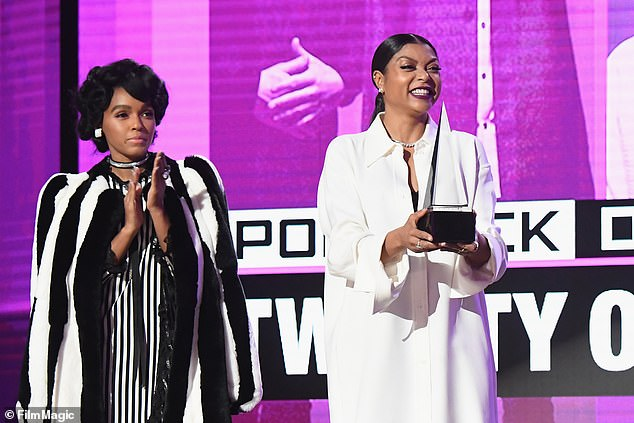 She loves the show! Presenters Janelle Monae (L) and Henson onstage at the 2016 American Music Awards at Microsoft Theater in 2016 in Los Angeles