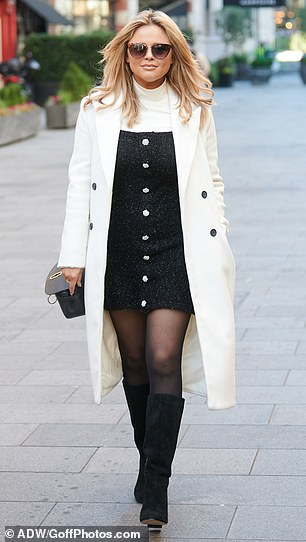 Finishing touches: The look was completed with a pair of knee-high black boots which gave the ensemble a 60s feel