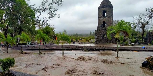 Floodwaters pass by Cagsawa ruins, a famous tourist spot in Daraga, Albay province, central Philippines as Typhoon Goni hit the area on Sunday, Nov. 1, 2020.