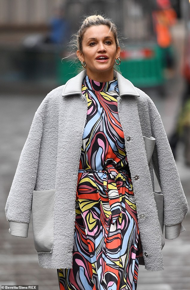 Outfit: Ashley wrapped up for the day in a grey coat while she also wore a pair of gold hoop earrings