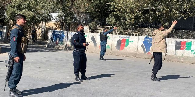 Afghan police arrive at the site of an attack at Kabul University in Kabul, Afghanistan, Monday, Nov. 2, 2020. Gunfire erupted at the university in the Afghan capital early Monday and police have surrounded the sprawling campus, authorities said. (AP Photo/Rahmat Gul)