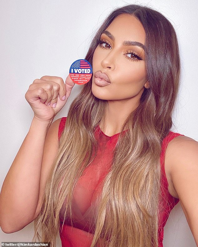 She did it: The KKW Beauty mogul posted this image on Tuesday; it is not known if she voted for her husband Kanye West or her pal Donald Trump but the red suggested her choice was Trump