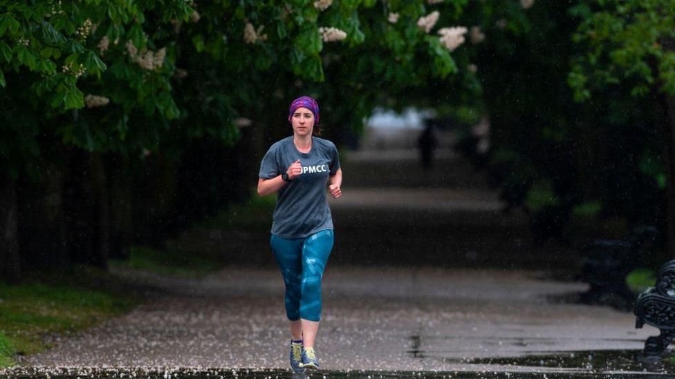 Jogger running along