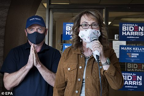 Campaign: Gabrielle Giffords speaks for her husband Mark Kelly who is beating the Republican appointed senator, Martha McSally, in Arizona polls