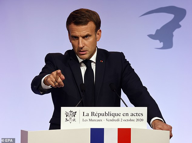 Emmanuel Macron (pictured on October 2) described Islam as 'a religion that is in crisis all over the world' as he unveiled a proposal to battle Islamic radicalism which had created a 'parallel society' living outside of French values