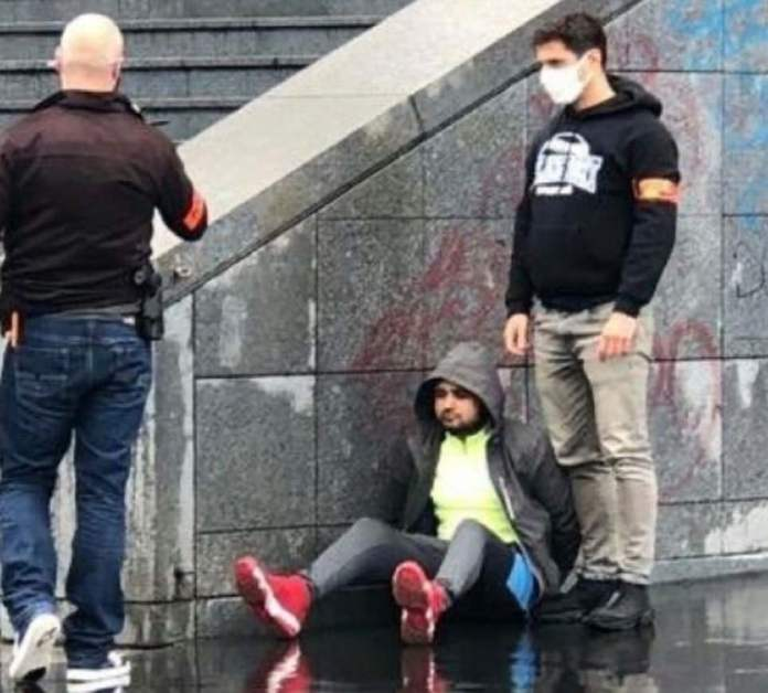Two people were stabbed with a meat cleaver in Paris on September 25 this year. Pictured: A suspect being detained after the attack