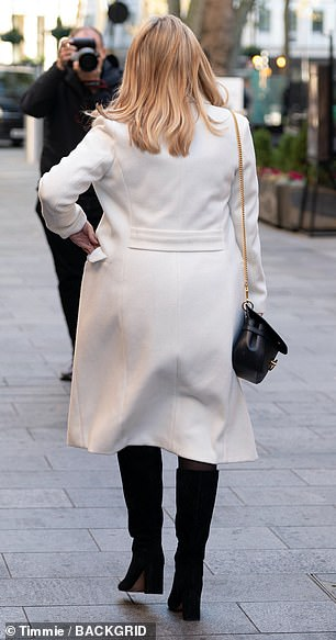 Covered up: The actress and comedienne stayed warm beneath a sweeping cream winter coat