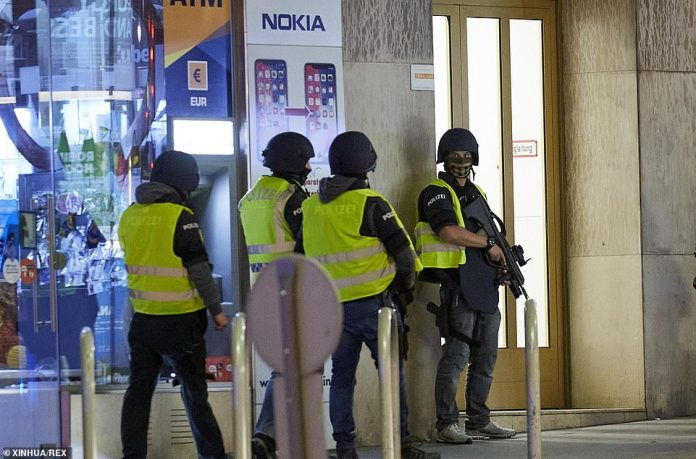 Heavily armed police officers who moved in last night as at least one gunman terrorised the Austrian capital