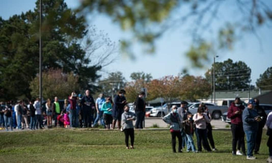 Voters wait in line to cast ballots at Savannah Grove Baptist church in Effingham, South Carolina.