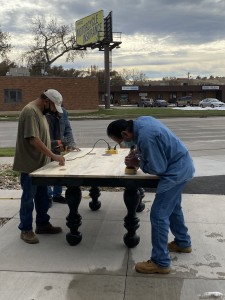 Participants working furniture, courtesy Facebook