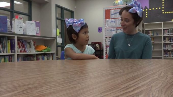 teacher cuts waist-length hair to support 5-year-old girl