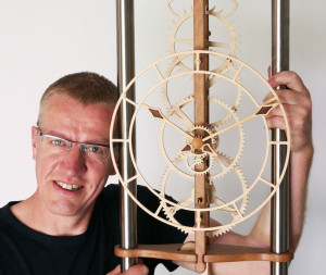 Dave Atkinson with one of his wooden clocks