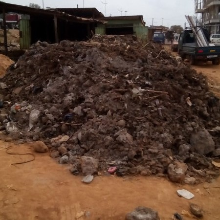 heaped refuse dump in front of a shop