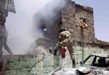 A man tries to put out the fire in Sanaa, Yemen, on April 20, 2015. At least 60 people were killed and 49 others wounded in Yemen's capital of Sanaa on Monday morning in one of the fiercest air raids by Saudi-led coalition forces that began more than three weeks ago. (Xinhua/Hani Ali)