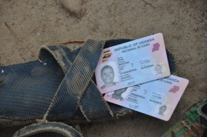 Photo taken on July 23, 2015 shows identity cards placed on a traditional sandal in Kotido district, northeastern Uganda. The Uganda Electoral Commission stated that the national identification card will not be a pre-requisite for one to vote in the 2016 general elections. Xinhua/Daniel Edyegu)
