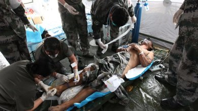 A rescued man receives medical treatment at a hospital of the People's Liberation Army in Tianjin, north China, Aug. 15, 2015. The man in his fifties was rescued from the Tianjin blasts site on Saturday afternoon. Specialized anti-chemical soldiers found him 50 meters away from a burst point. The man was conscious and could talk. He was rushed to a hospital in the city. A total of 70 specialized anti-chemical soldiers entered the core area of the blasts site on Saturday morning to search for possible lives. (Xinhua/Wang Haobo) (lfj)