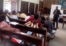Dr. Raphael Nyarkotey Obu delivering the lecture on psychosocial oncology to psychosocial counseling students Akona School of Counseling, Mampong
