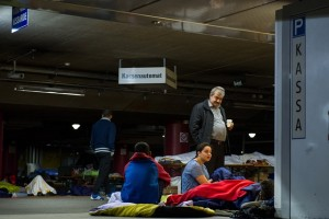 """Refugees rest at the parking lot of a railway station in Salzburg, Austria, on Sept. 14. 2015. German Interior Minister Thomas de Maiziere on Sunday announced that Germany temporarily reinstates border control amid the ongoing refugee crisis. According to German newspaper """"Passauer Neue Presse"""", the German government also stopped the trains to and from Austria. (Xinhua/Qian Yi)"""
