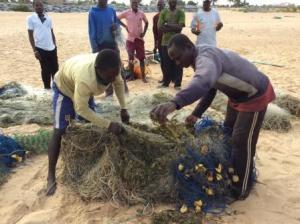 Fishermen mending their fishing net