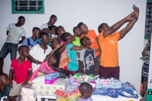 Hello Food Managing Director, Mr. Sofiène Marzouki with children of the Teshie orphanage