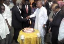 First NUGS President, Lawyer Thomas Brew (L) assisting Mr. Samuel Okudzeto-Ablakwa to launch the NUGS@50 anniversary celebrations