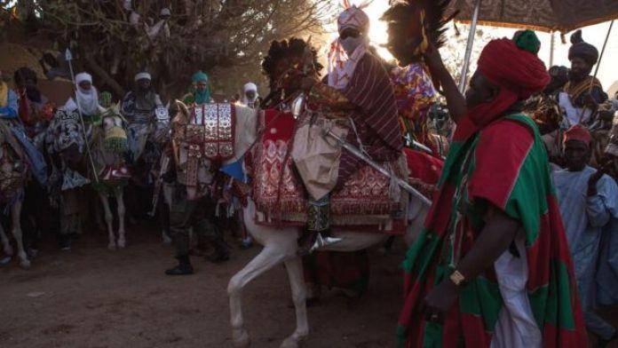 Emir passing through Kano on horseback