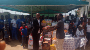 Rev Issac Mensah (in jacket) handling over the items to the Teshie Orphanage